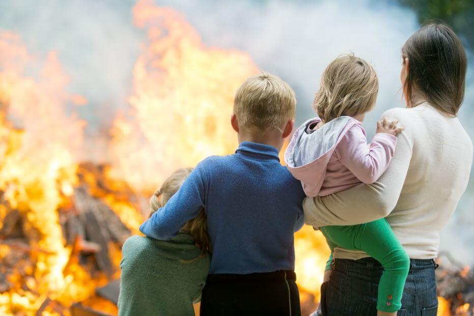 Family watching their house burn.